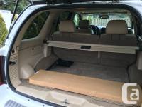 Make Oldsmobile Model Bravada Year 2004 Colour White