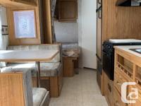* Sleeps 7 * Measures 18.5' Interior Length/ 24' Bumper