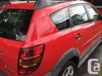 Make Pontiac Model Vibe Year 2004 Colour Red Trans