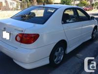 Make Toyota Model Corolla Year 2004 Colour White kms
