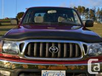 Make Toyota Model Tacoma Xtra Year 2004 Colour Red kms
