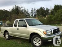 Make Toyota Model Tacoma Year 2004 Colour Grey kms