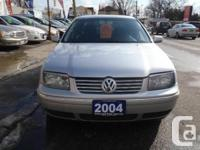 Silver with 4 cylinder manual transmission, air-con,