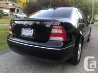 Make Volkswagen Model Jetta Year 2004 Colour Black kms