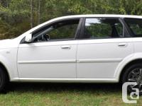 Make Chevrolet Model Optra Year 2005 Colour White kms