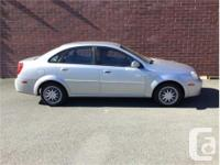Make Chevrolet Model Optra Year 2005 Colour Silver kms