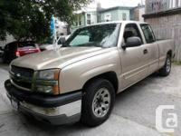Gold with 8 cylinder automatic transmission, air-con,