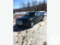 Up for sale is a Black with Chrome Chrysler 300 series!