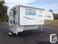 This Citation Supreme Model 990 Slide-out camper is in