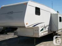 This mint condition fifth wheel sleeps 7 and has a full