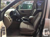 Make Ford Model Escape Year 2005 Colour Green kms