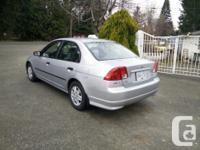 Make Honda Model Civic Sedan Year 2005 Colour Silver