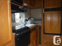 Rear Kitchen ,Pantry, Microwave, 3burner range/oven,