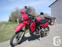 9348 km bike has new grips and gel seat, tank bag, and