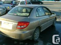 Make Kia Model Rio Year 2005 Colour gold kms 144200