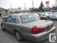 Make Mercury Model Grand Marquis Year 2005 Colour GOLD