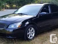 Make Nissan Model Altima Year 2005 Colour Black kms