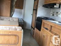 2005, 19 ft Pioneer. Front sofa, Booth dinette, rear