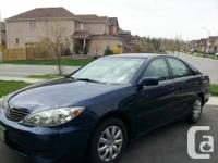Blue 2005 Toyota Camry LE model.  Cloth seats.