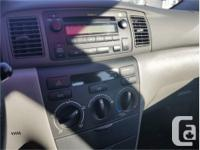 Make Toyota Model Corolla Year 2005 Colour Grey kms