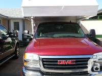 2006 4x4 GMC Sierra 2500HD Extended Cab with short box.