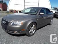 Make Audi Model A4 Year 2006 Colour brown kms 202471