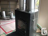 2006 BIS panorama wood stove with 23' stainless steel