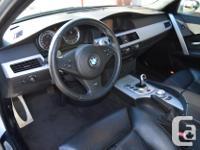 Make BMW Model M5 Year 2006 Colour Silver kms 50468