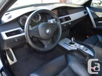 Make BMW Model M5 Year 2006 Colour Silver kms 50468