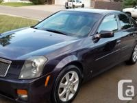 Make Cadillac Model CTS Year 2006 Colour Blackberry
