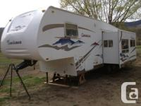 2006 Coachmen Chaparral. Model 276RLS, GVWR is 9520lbs.
