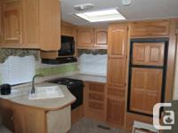 Very well kept & fully optioned unit with ducted heat &