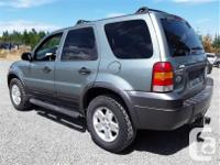 Make Ford Model Escape Year 2006 Colour Green kms