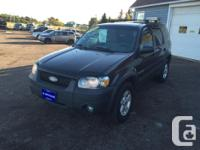 Make Ford Model Escape Year 2006 Colour GRAY kms