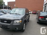 Make Ford Model Escape Year 2006 Colour grey kms