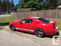 Make Ford Model Mustang Year 2006 Colour Red with White