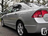 Make Honda Model Civic Sedan Year 2006 Colour Silver
