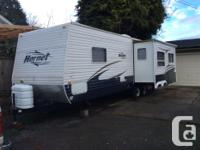 Trailer is in outstanding disorder, with 12 ft. Living
