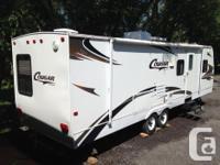 Spacious fiberglass camper in excellent condition.