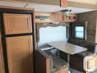 This fifth-wheel has a unique layout with bunks in the