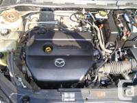 Make Mazda Model 3 Year 2006 Colour Biege kms 122500