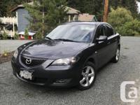Make Mazda Model 3 Year 2006 Colour Dark Grey kms