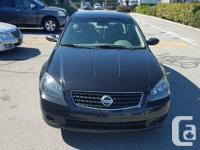 Make Nissan Model Altima Year 2006 Colour Black kms