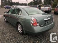 Make Nissan Model Altima Year 2006 Colour Green kms