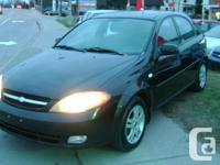 Make Chevrolet Model Optra Year 2006 Colour Black kms