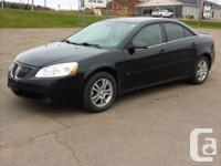 Make. Pontiac. Version. G6. Year. 2006. Colour. Black.