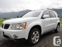 We are selling our white 2006 Pontiac Torrent.  * There