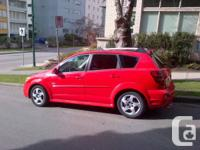 Red Pontiac Vibe manual hatchback. 108,000km.