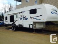2006 Sierra 325RGD Fifth Wheel. It has two slides, in