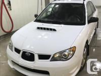 Make Subaru Model Impreza Colour White kms 143000